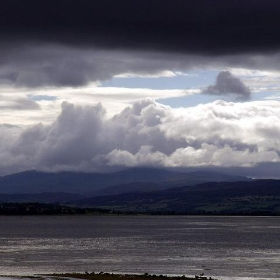 Dark clouds over western end of Beauly Firth Inverness Scotland - conner395