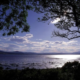 Redcastle Bay looking towards the mountains of Western Inverness-shire and Ross-shire Black Isle Scotland - conner395