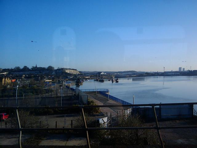 Train ride into work over medway river.