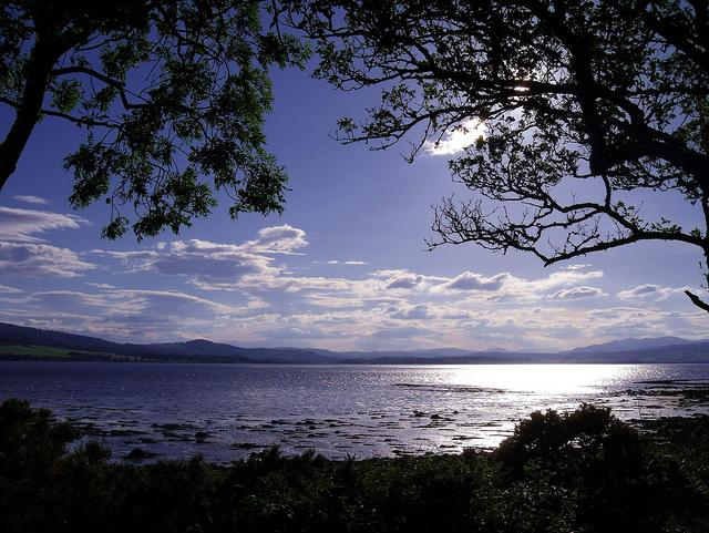 Redcastle Bay looking towards the mountains of Western Inverness-shire and Ross-shire Black Isle Scotland